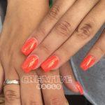 Orange Nägel mit Meerjungfrauen Glimmer (mermaid powder) bei Creative Nails